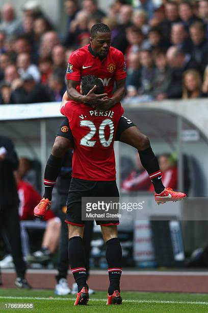 Robin van Persie of Manchester United celebrates scoring his sides third goal with Patrice Evra during the Barclays Premier League match between...