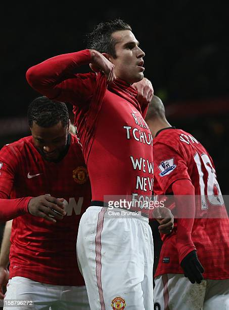 Robin van Persie of Manchester United celebrates scoring his team's second goal during the Barclays Premier League match between Manchester United...