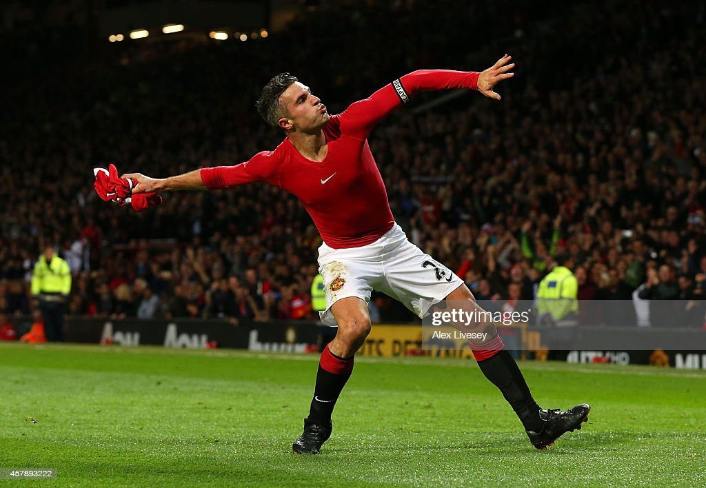Robin van Persie of Manchester United celebrates scoring the equalising goal during the Barclays Premier League match between Manchester United and Chelsea at Old Trafford on October 26, 2014 in Manchester, England.