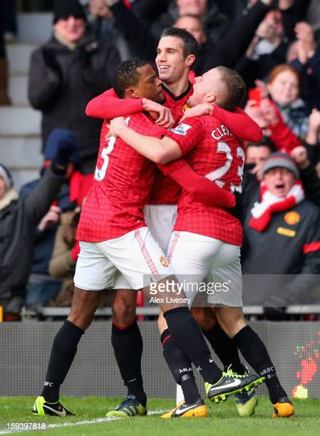 Robin van Persie of Manchester United celebrates scoring the opening goal with teammates Patrice Evra and Tom Cleverley during the Barclays Premier...