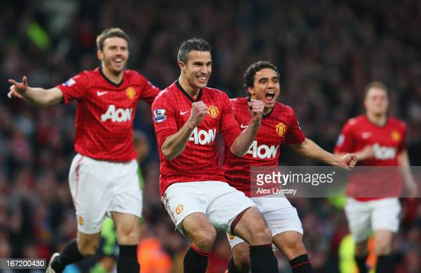 Robin van Persie of Manchester United celebrates scoring the opening goal with Michael Carrick and Rafael during the Barclays Premier League match...