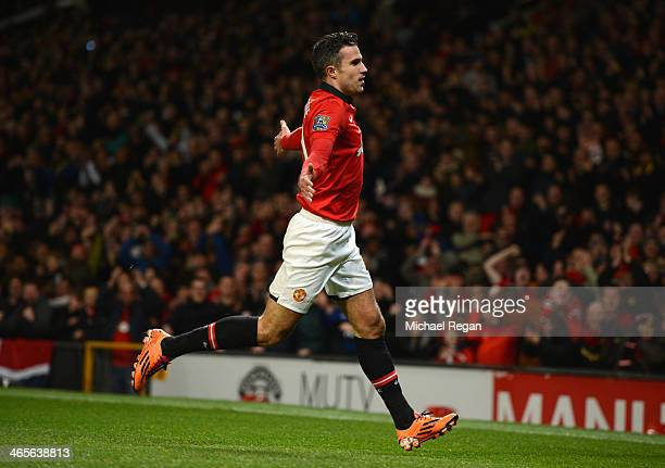 Robin van Persie of Manchester United celebrates scoring the opening goal during the Barclays Premier League match between Manchester United and...