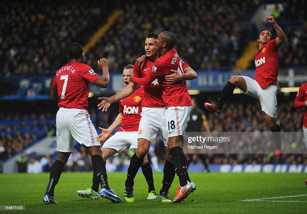 Robin van Persie of Manchester United celebrates scoring the second goal with Ashley Young during the Barclays Premier League match between Chelsea and Manchester United at Stamford Bridge on October 28, 2012 in London, England.