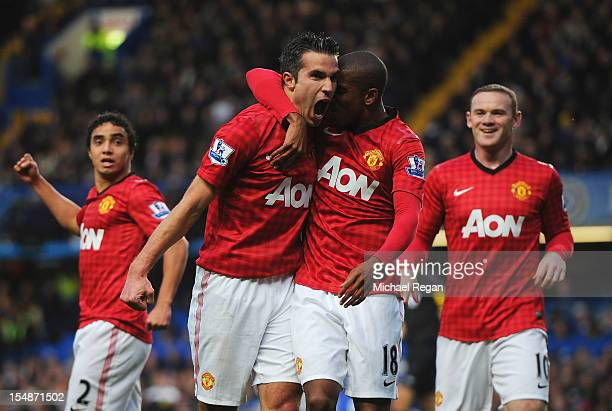 Robin van Persie of Manchester United celebrates scoring the second goal with Ashley Young during the Barclays Premier League match between Chelsea...