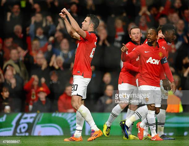 Robin van Persie of Manchester United celebrates scoring the third goal from a freekick to complete his hattrick during the UEFA Champions League...