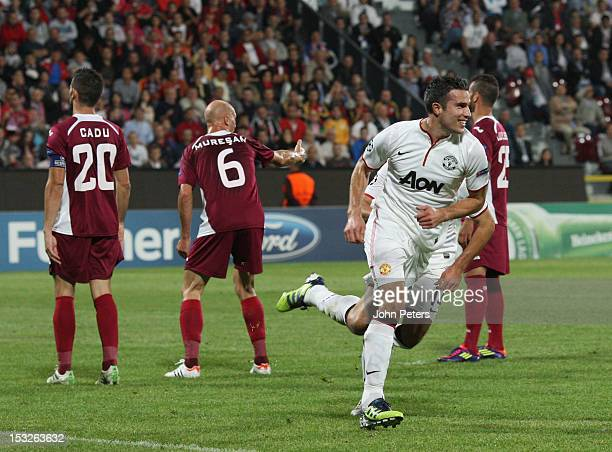 Robin van Persie of Manchester United celebrates scoring their first goal during the UEFA Champions League Group H match between CFR 1907 Cluj and...