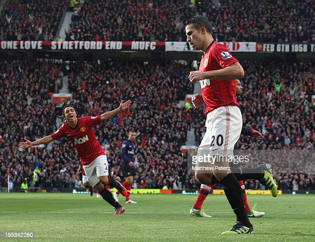 Robin van Persie of Manchester United celebrates scoring their first goal during the Barclays Premier League match between Manchester United and...