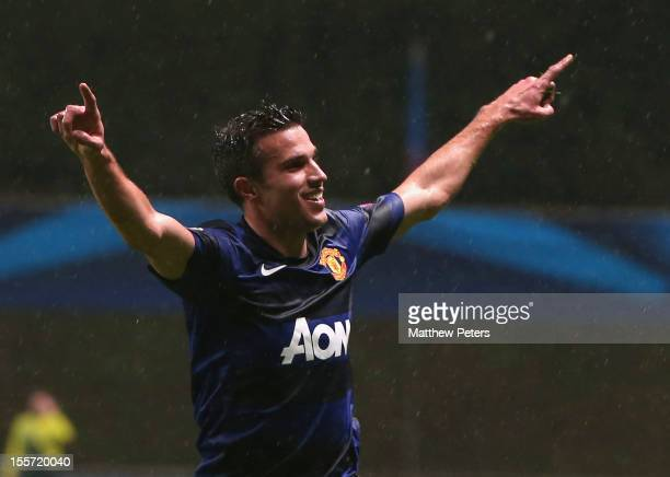 Robin van Persie of Manchester United celebrates scoring their first goal during the UEFA Champions League Group H match between SC Braga and...
