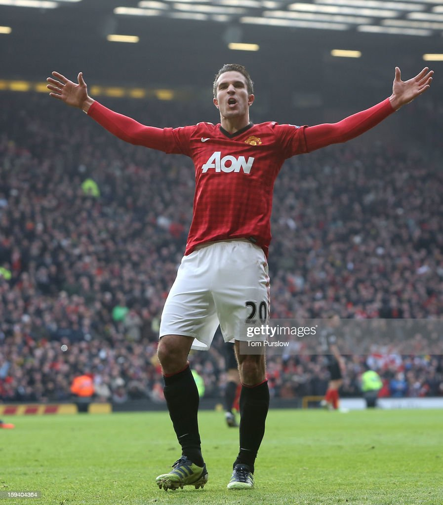 Robin van Persie of Manchester United celebrates scoring their first goal during the Barclays Premier League match between Manchester United and Liverpool at Old Trafford on January 13, 2013 in Manchester, England.