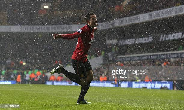 Robin van Persie of Manchester United celebrates scoring their first goal during the Barclays Premier League match between Tottenham Hotspur and...