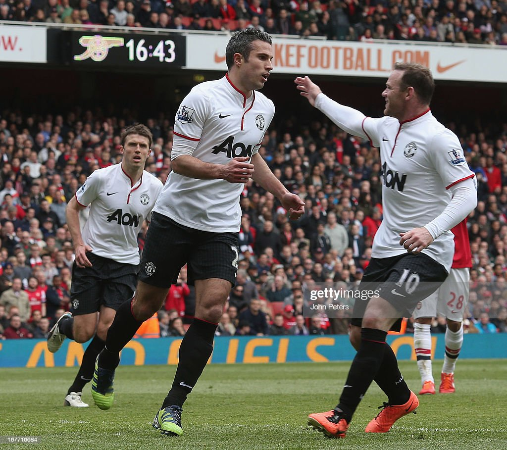 Robin van Persie of Manchester United (L) celebrates scoring their first goal during the Barclays Premier League match between Arsenal and Manchester United at Emirates Stadium on April 28, 2013 in London, England.