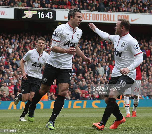 Robin van Persie of Manchester United celebrates scoring their first goal during the Barclays Premier League match between Arsenal and Manchester...