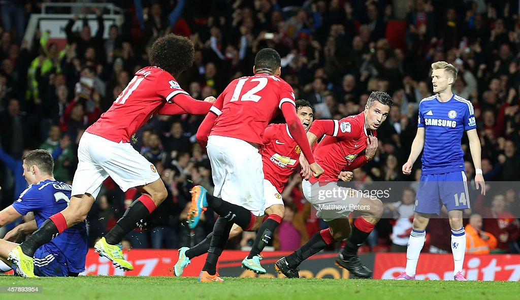 Robin van Persie of Manchester United celebrates scoring their first goal during the Barclays Premier League match between Manchester United and Chelsea at Old Trafford on October 26, 2014 in Manchester, England.