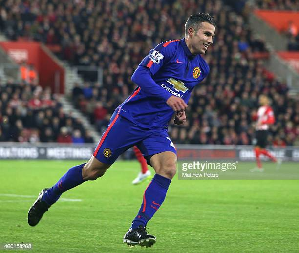 Robin van Persie of Manchester United celebrates scoring their first goal during the Barclays Premier League match between Southampton and Manchester...