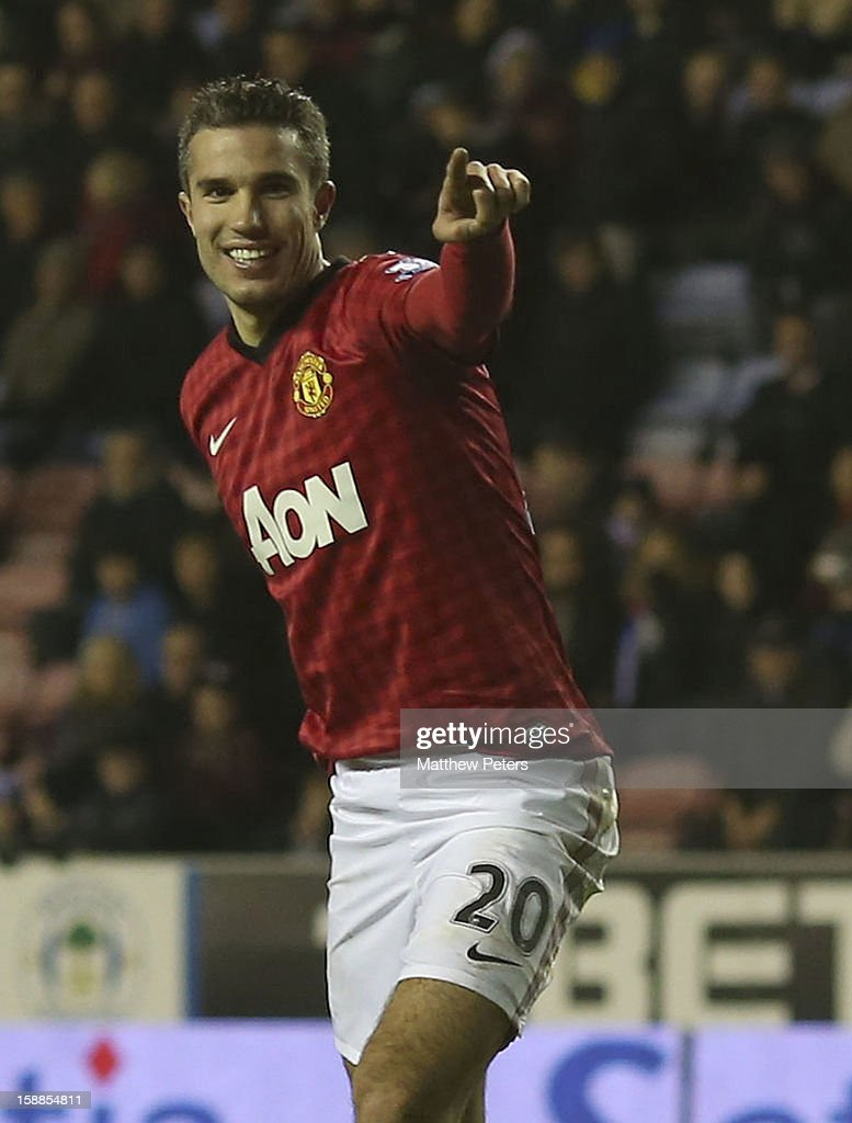 Robin van Persie of Manchester United celebrates scoring their fourth goal during the Barclays Premier League match between Wigan Athletic and Manchester United at DW Stadium on January 1, 2013 in Wigan, England.