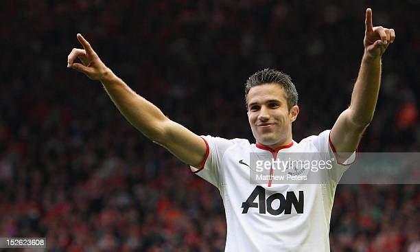 Robin van Persie of Manchester United celebrates scoring their second goal during the Barclays Premier League match between Liverpool and Manchester...