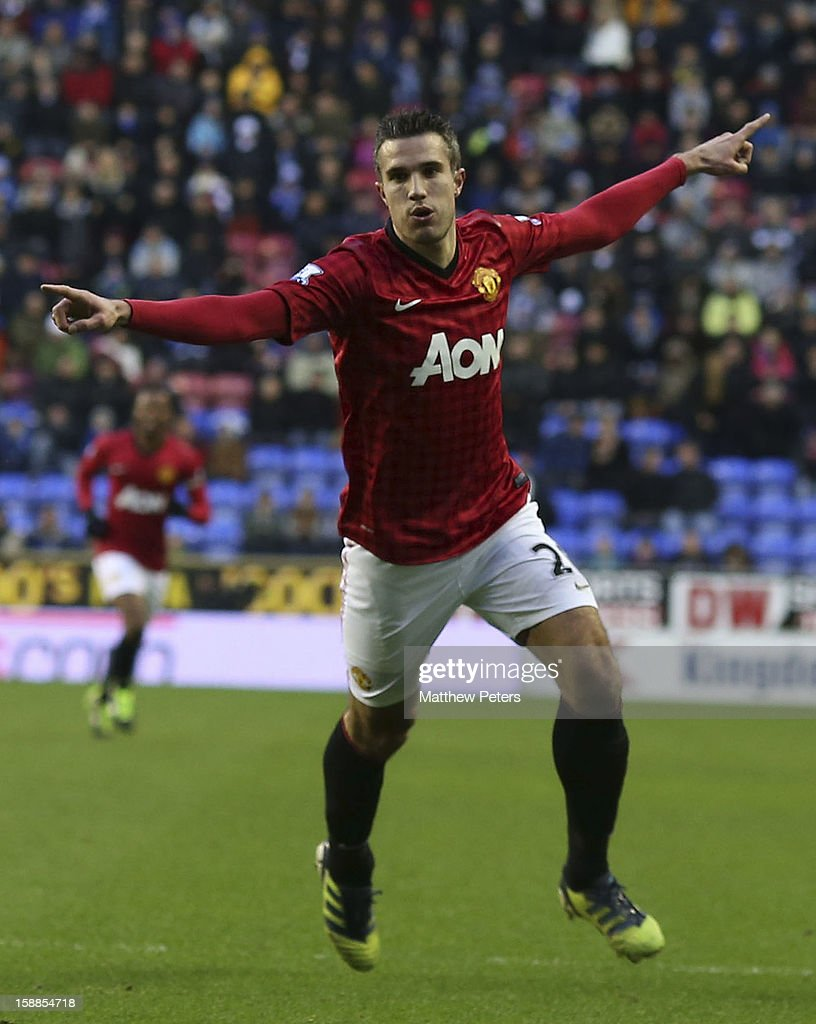 Robin van Persie of Manchester United celebrates scoring their second goal during the Barclays Premier League match between Wigan Athletic and Manchester United at DW Stadium on January 1, 2013 in Wigan, England.