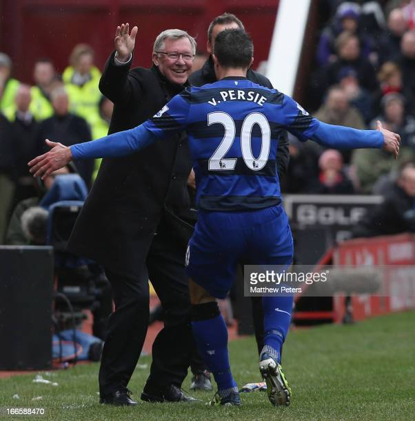 Robin van Persie of Manchester United celebrates scoring their second goal with manager Sir Alex Ferguson during the Barclays Premier League match...