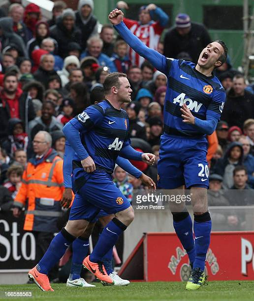 Robin van Persie of Manchester United celebrates scoring their second goal n during the Barclays Premier League match between Stoke City and...