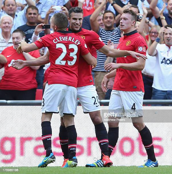 Robin van Persie of Manchester United celebrates scoring their second goal during the FA Community Shield match between Manchester United and Wigan...