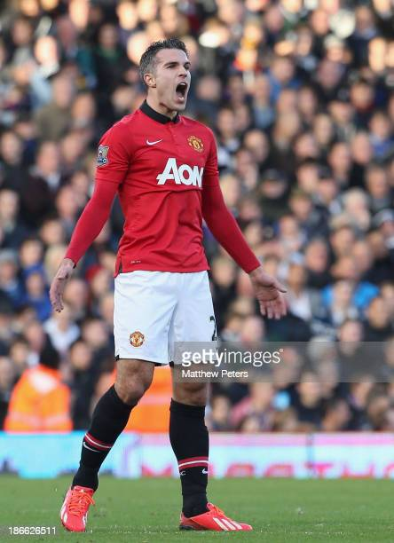 Robin van Persie of Manchester United celebrates scoring their second goal during the Barclays Premier League match between Fulham and Manchester...