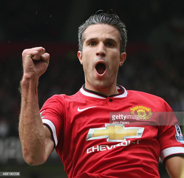 Robin van Persie of Manchester United celebrates scoring their second goal during the Barclays Premier League match between Manchester United and...