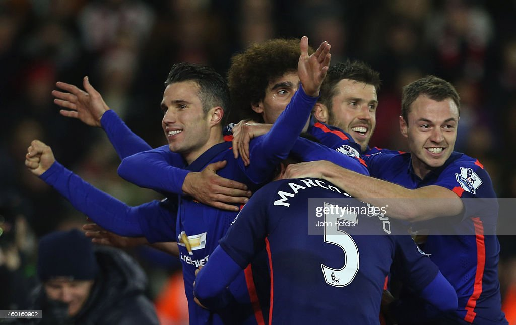 Robin van Persie of Manchester United celebrates scoring their second goal during the Barclays Premier League match between Southampton and Manchester United at St Mary's Stadium on December 8, 2014 in Southampton, England.