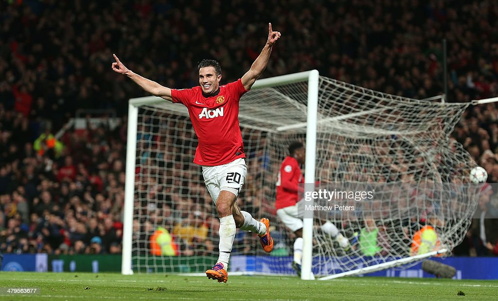 Robin van Persie of Manchester United celebrates scoring their second goal during the UEFA Champions League Round of 16 second leg match between Manchester United and Olympiacos FC at Old Trafford on March 19, 2014 in Manchester, England.