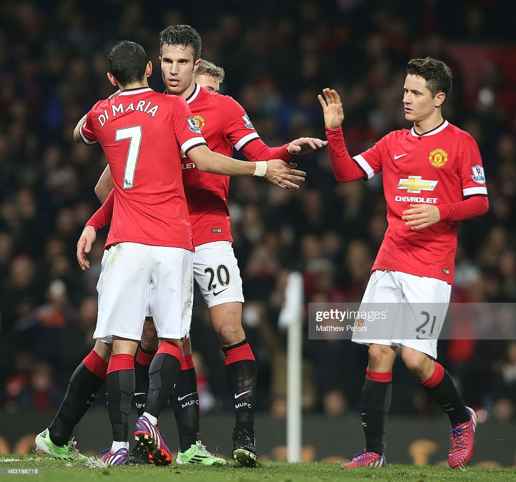 Robin van Persie of Manchester United celebrates scoring their third goal during the Barclays Premier League match between Manchester United and Burnley at Old Trafford on February 11, 2015 in Manchester, England.