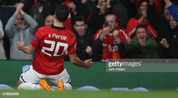 Robin van Persie of Manchester United celebrates scoring their third goal during the UEFA Champions League Round of 16 second leg match between...