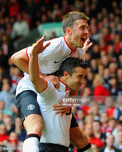Robin Van Persie of Manchester United celebrates scoring to make it 21 with Michael Carrick during the Barclays Premier League match between...