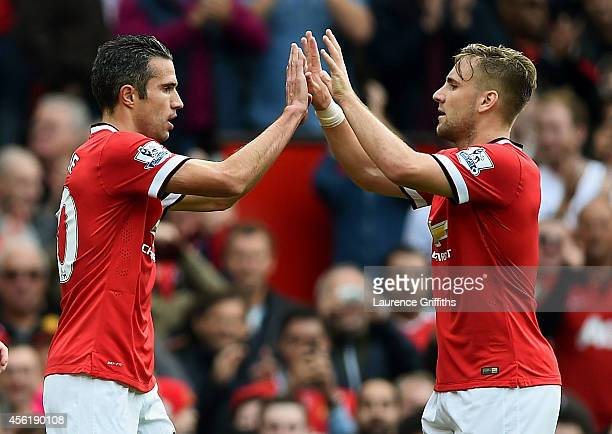 Robin van Persie of Manchester United celebrates with teammate Luke Shaw of Manchester United after scoring his team's second goal during the...