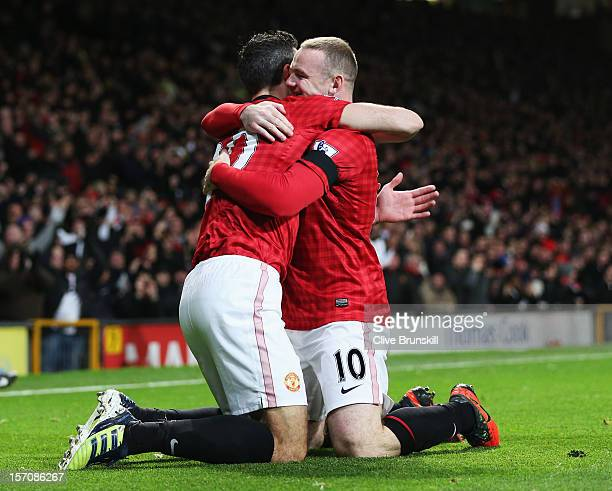 Robin van Persie of Manchester United celebrates with Wayne Rooney of Manchester United as he scores their first goal during the Barclays Premier...