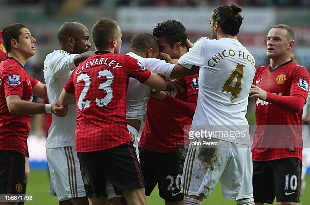 Robin van Persie of Manchester United clashes with Ashley Williams of Swansea City during the Barclays Premier League match between Swansea City and...