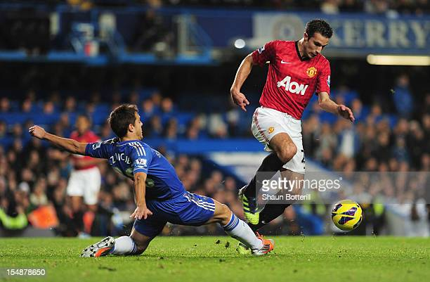 Robin van Persie of Manchester United evades a challenge by Cesar Azpilicueta of Chelsea during the Barclays Premier League match between Chelsea and...
