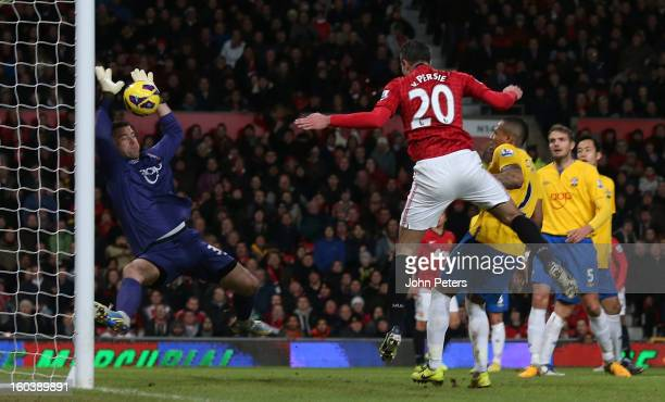 Robin van Persie of Manchester United has a header saved by Artur Boruc of Southampton during the Barclays Premier League match between Manchester...