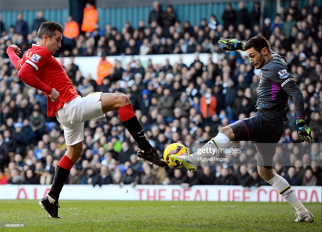 Robin van Persie of Manchester United has his attempt on goal saved by goalkeeper Hugo Lloris of Spurs during the Barclays Premier League match between Tottenham Hotspur and Manchester United at White Hart Lane on December 28, 2014 in London, England.