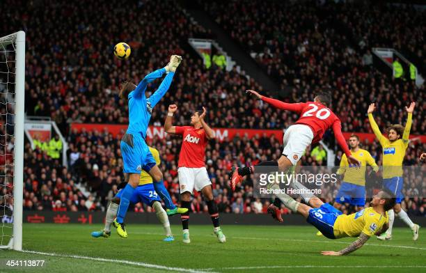 Robin van Persie of Manchester United heads over goalkeeper Tim Krul of Newcastle to score a goal that was dissallowed for offside during the...