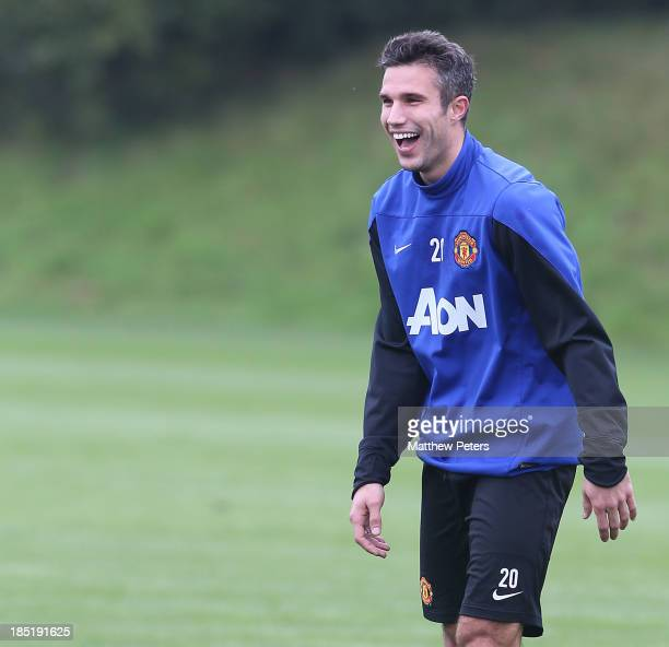 Robin van Persie of Manchester United in action during a first team training session at Aon Training Complex on October 18 2013 in Manchester England