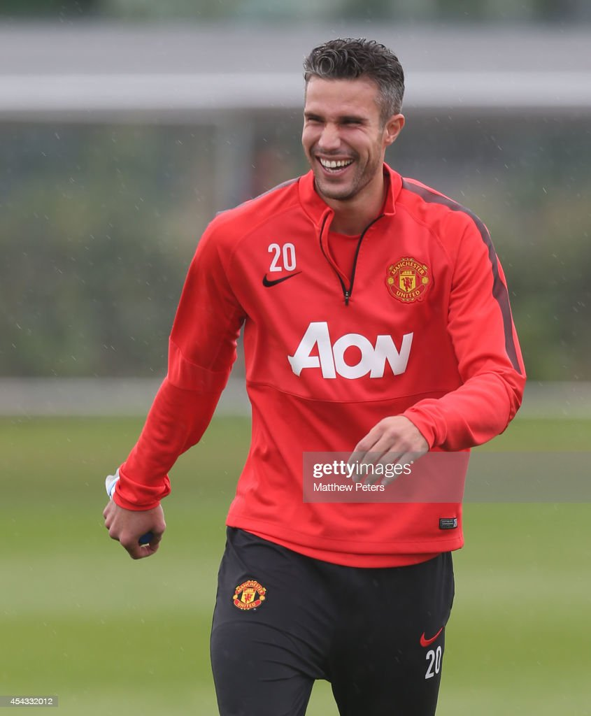 Robin van Persie of Manchester United in action during a first team training session at Aon Training Complex on August 29, 2014 in Manchester, England.