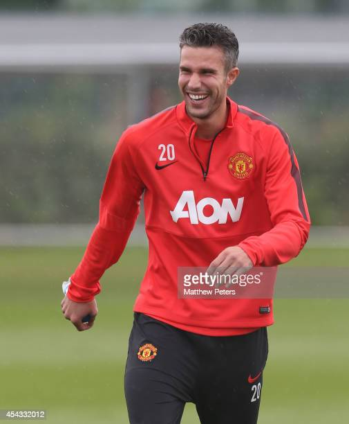 Robin van Persie of Manchester United in action during a first team training session at Aon Training Complex on August 29, 2014 in Manchester,...