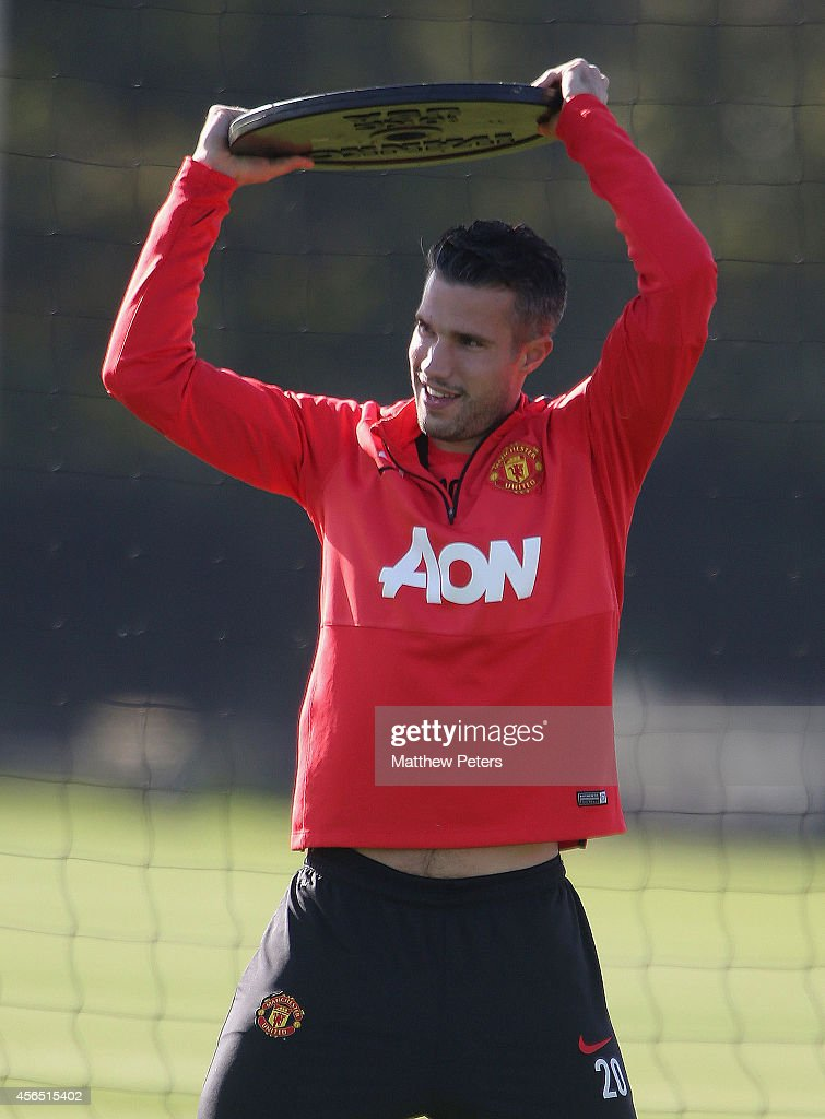 Robin van Persie of Manchester United in action during a first team training session at Aon Training Complex on October 2, 2014 in Manchester, England.