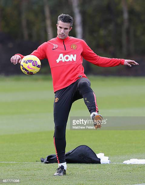 Robin van Persie of Manchester United in action during a first team training session at Aon Training Complex on October 24, 2014 in Manchester,...