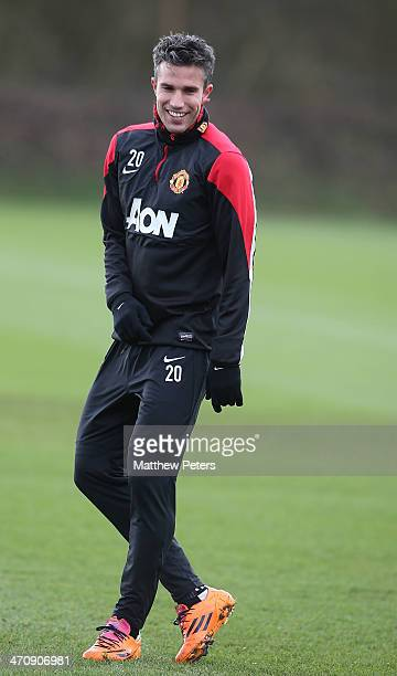 Robin van Persie of Manchester United in action during a first team training session at Aon Training Complex on February 21, 2014 in Manchester,...