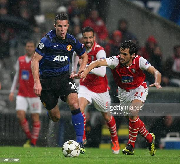 Robin van Persie of Manchester United in action with Custodio of SC Braga during the UEFA Champions League Group H match between SC Braga and...