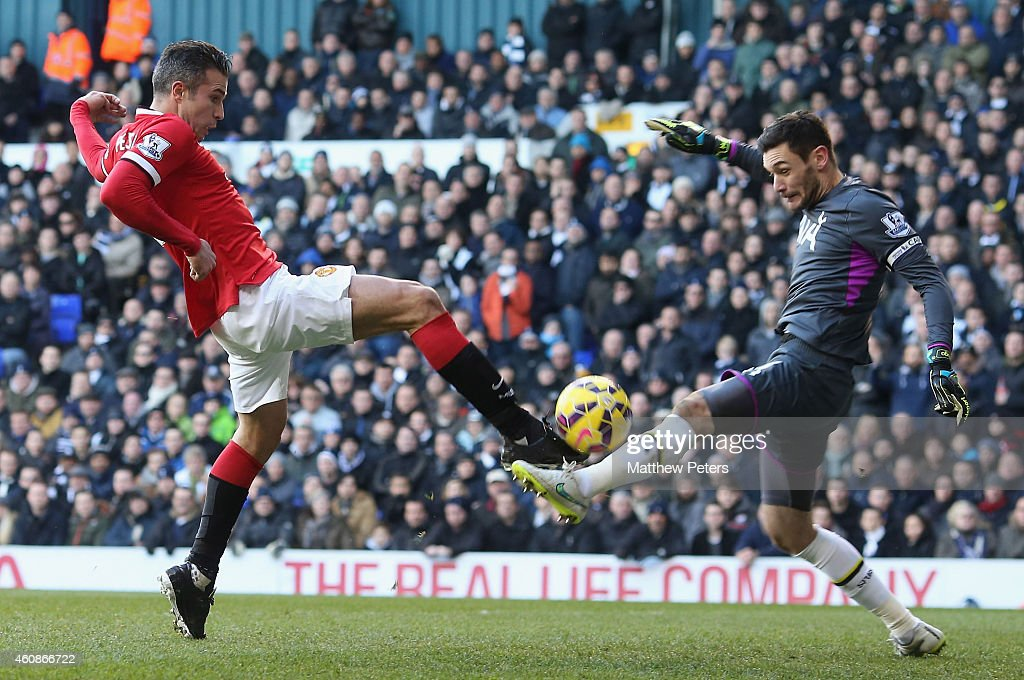 Robin van Persie of Manchester United in action with Hugo Lloris of Tottenham Hotspur during the Barclays Premier League match between Tottenham Hotspur and Manchester United at White Hart Lane on December 28, 2014 in London, England.