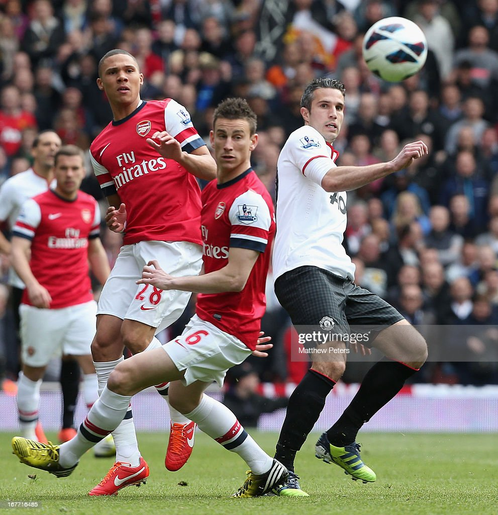 Robin van Persie of Manchester United in action with Kieran Gibbs and Laurent Koscielny of Arsenal during the Barclays Premier League match between Arsenal and Manchester United at Emirates Stadium on April 28, 2013 in London, England.