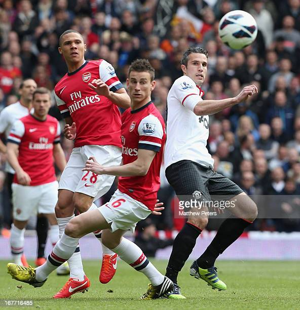 Robin van Persie of Manchester United in action with Kieran Gibbs and Laurent Koscielny of Arsenal during the Barclays Premier League match between...