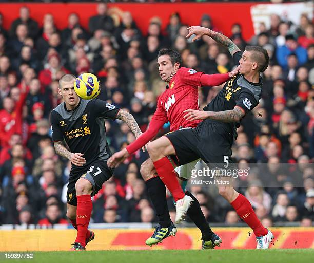 Robin van Persie of Manchester United in action with Martin Skrtel and Daniel Agger during the Barclays Premier League match between Manchester...