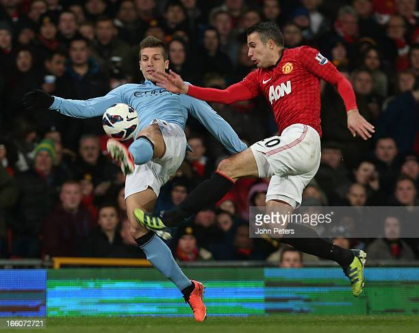 Robin van Persie of Manchester United in action with Matija Nastasic of Manchester City during the Barclays Premier League match between Manchester...